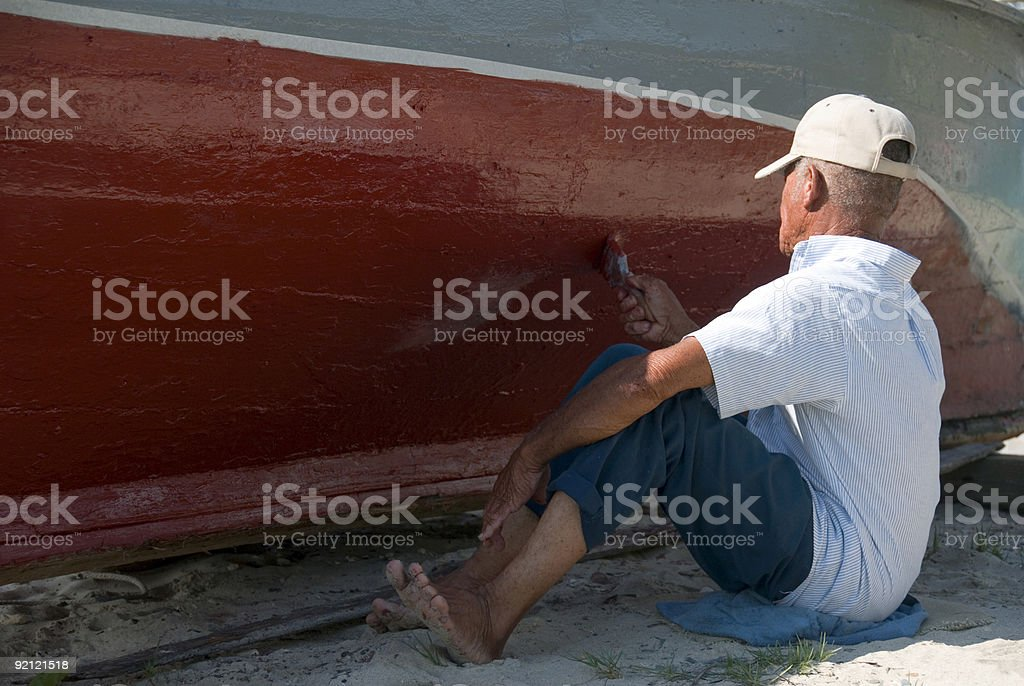 Painting a Boat royalty-free stock photo