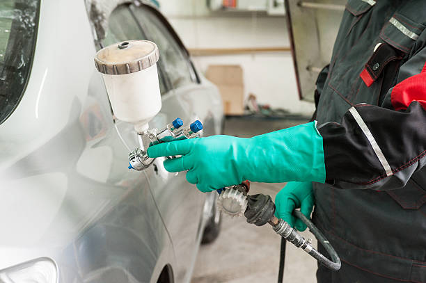 painting a car - auto body repair stock photos and pictures