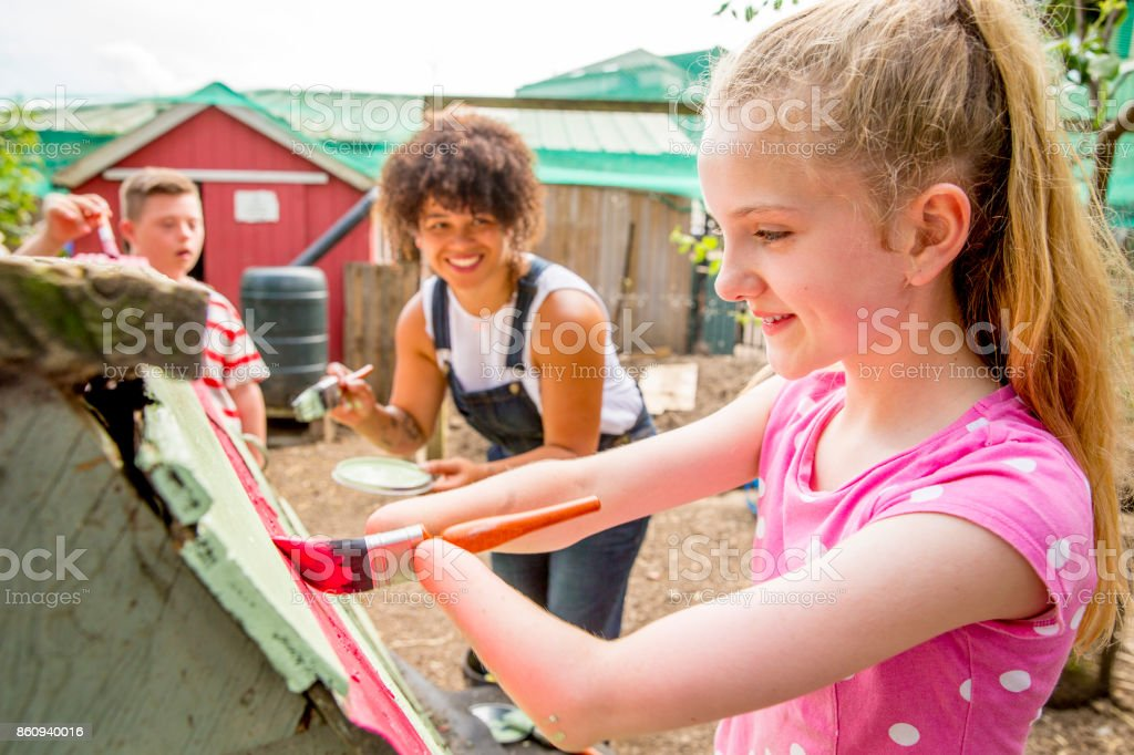 Painting a Chicken Coop at the Farm stock photo