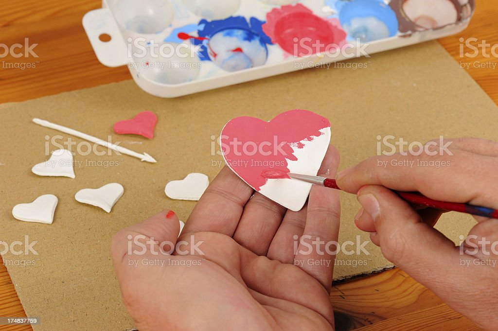 Painting a Clay Heart royalty-free stock photo