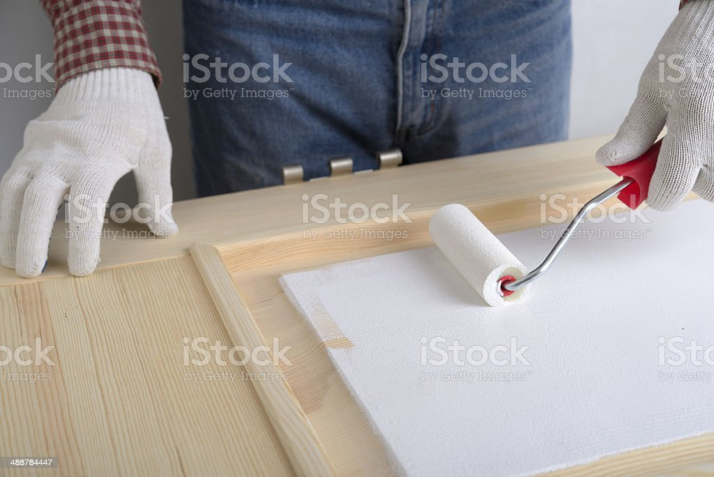 Painting a door stock photo