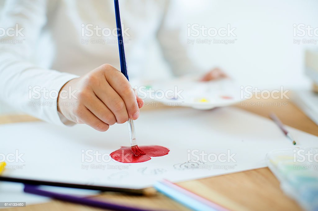 Painting a heart stock photo
