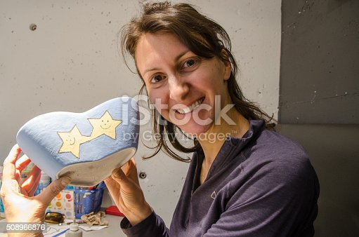 istock Painting a heart-shape pottery 508966876