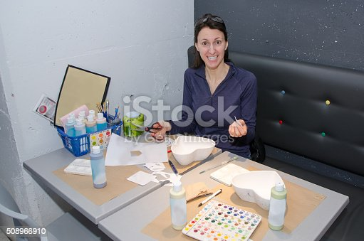 istock Painting a heart-shape pottery 508966910