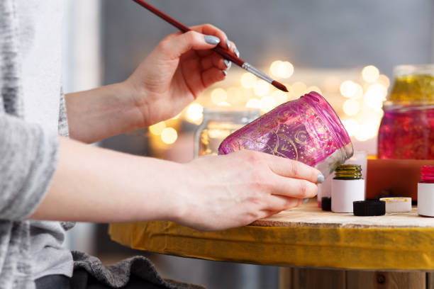 Painting a jar stock photo
