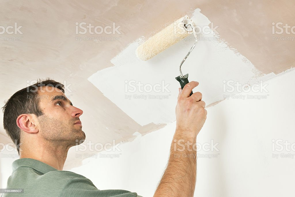 Painting a low ceiling by roller royalty-free stock photo