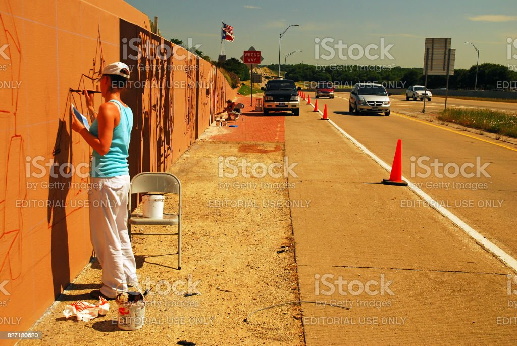 Painting a mural along the interstate stock photo