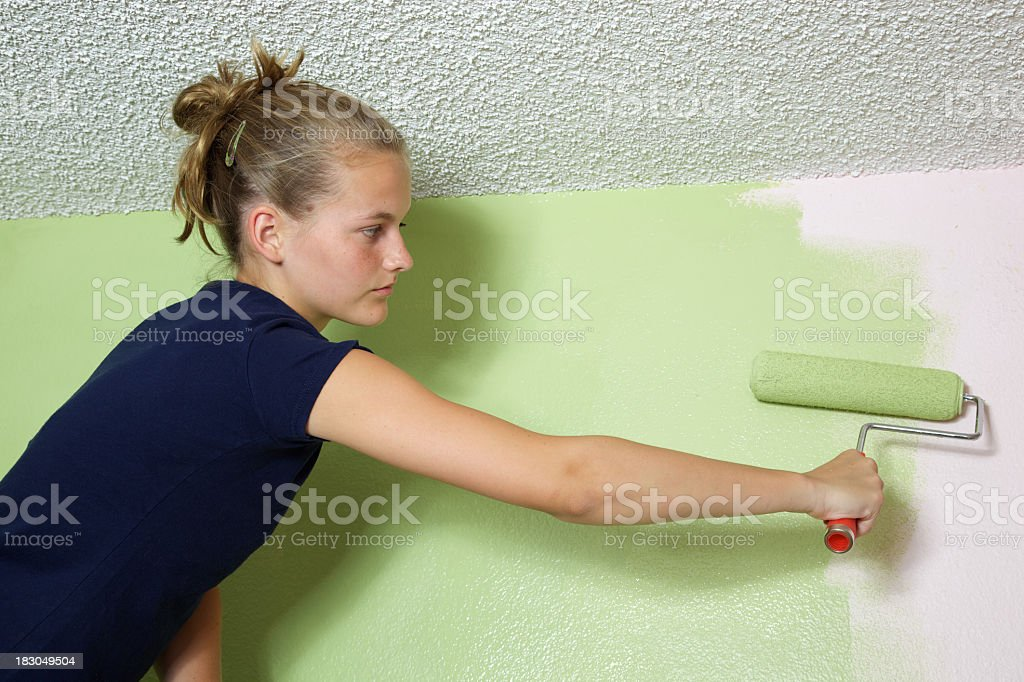 Painting a Room by teen Girl royalty-free stock photo