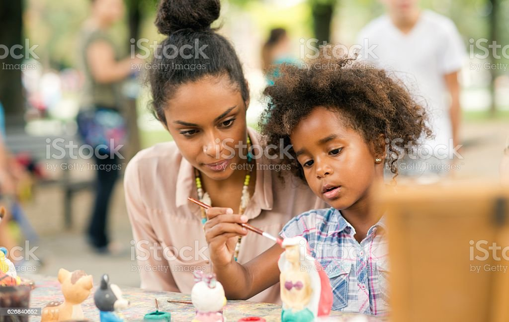 Painting a sculpture. stock photo