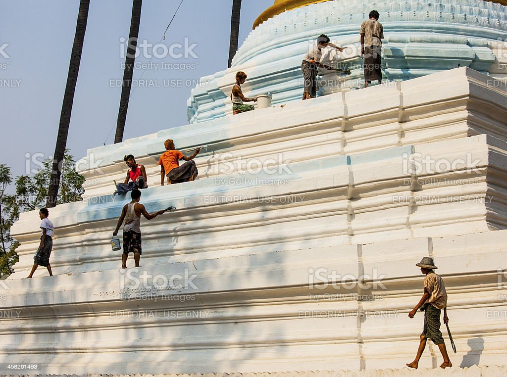 Painting a Stupa royalty-free stock photo