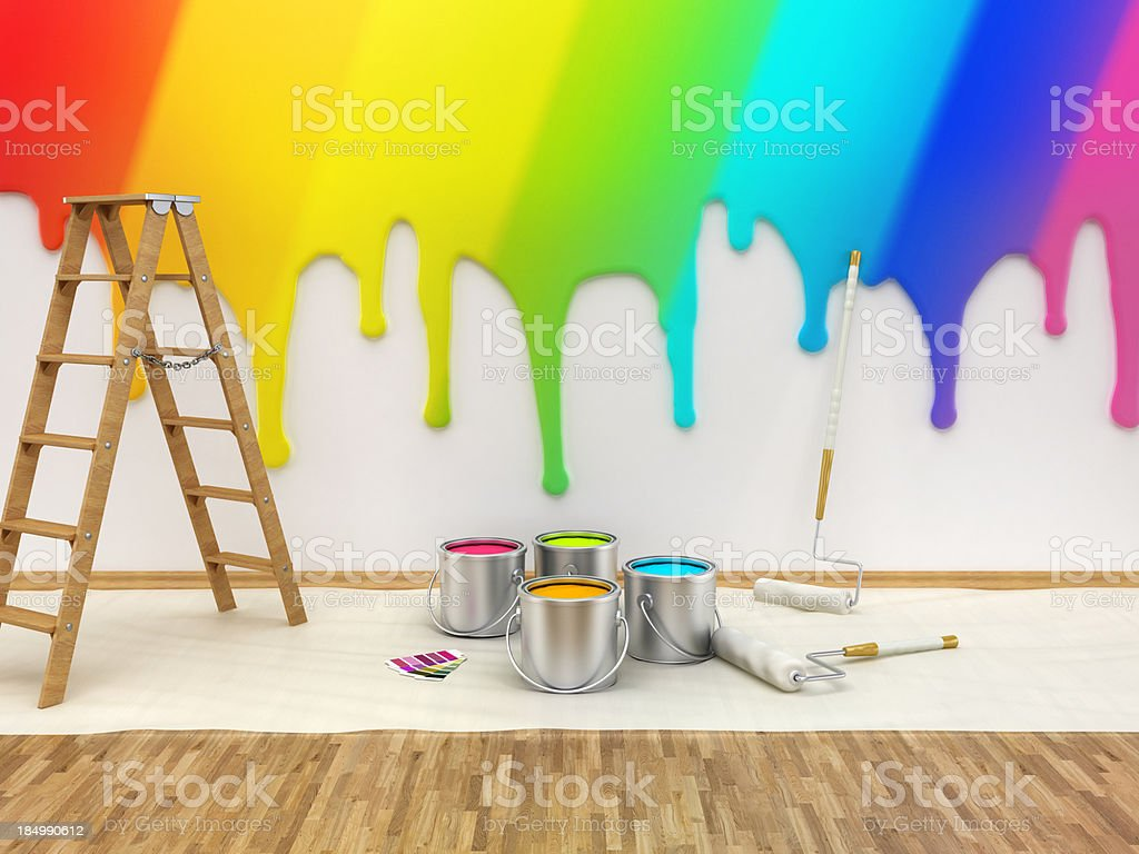 Painting accessories and a ladder next to a wall stock photo
