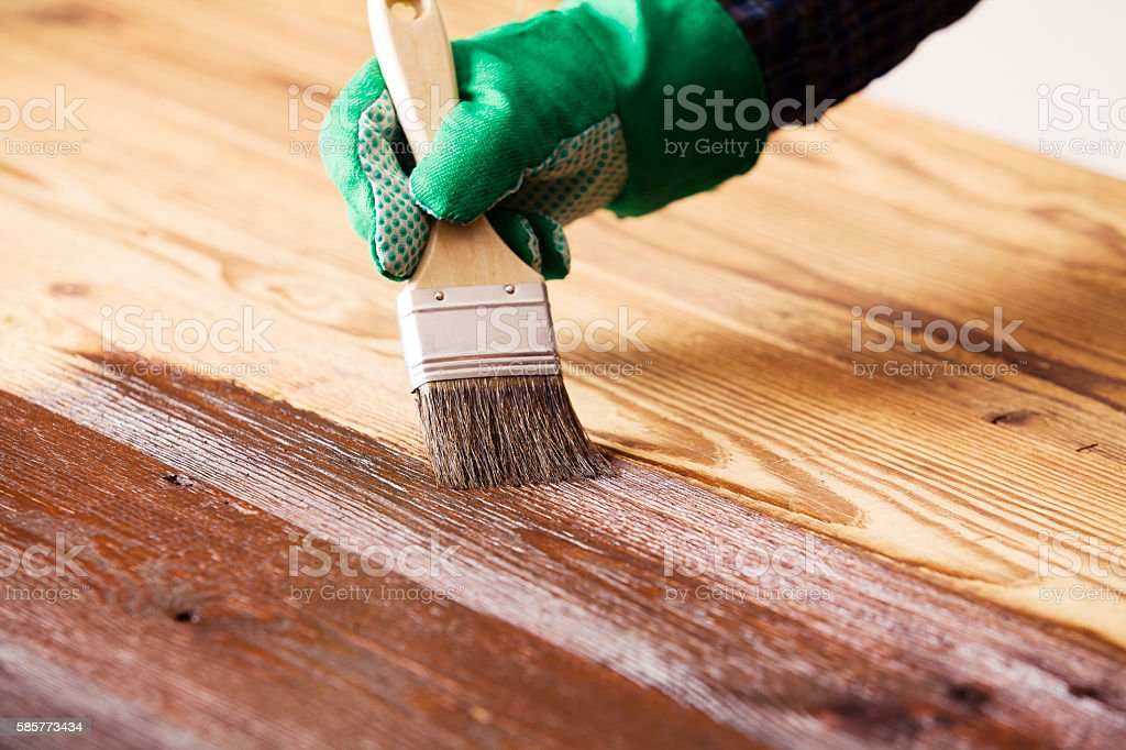 Painting and wood preservation stock photo