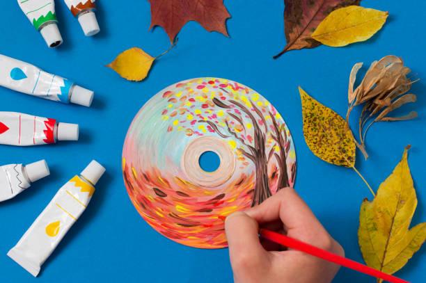 Painting autumn landscape on CD stock photo