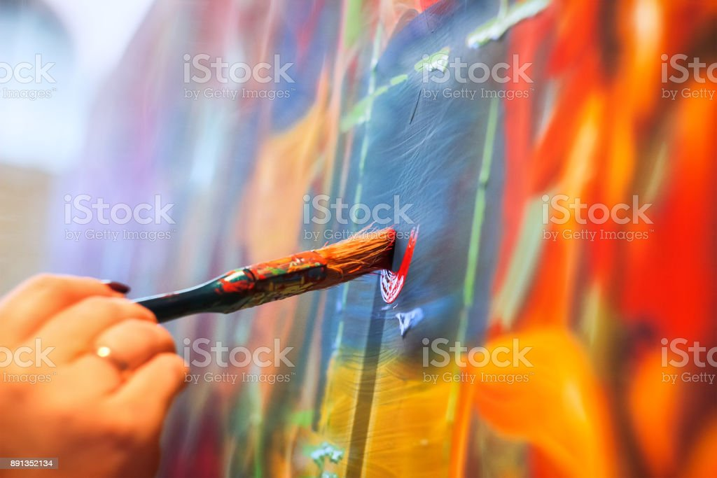 painting brush on wall stock photo