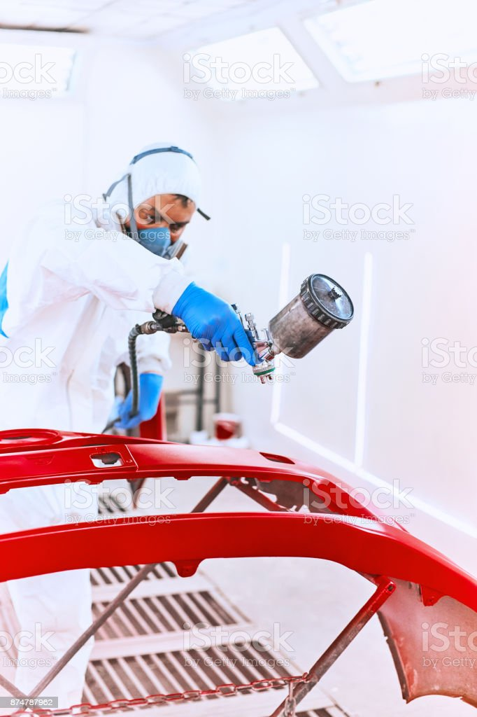 Painting bumpers machine red in the paint shop. stock photo