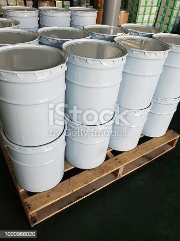 Painting color in white buckets in warehouse
