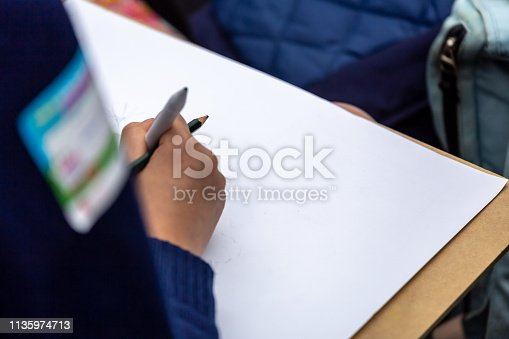 628812970 istock photo painting courses. student drawing at the park 1135974713