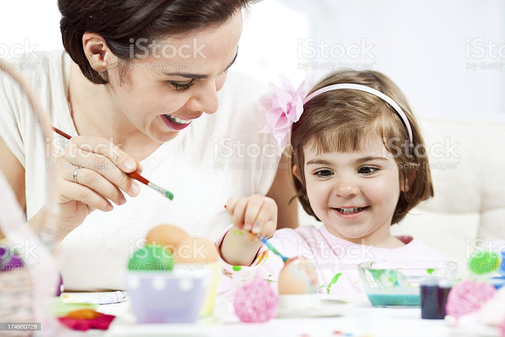 Painting Easter eggs is fun royalty-free stock photo