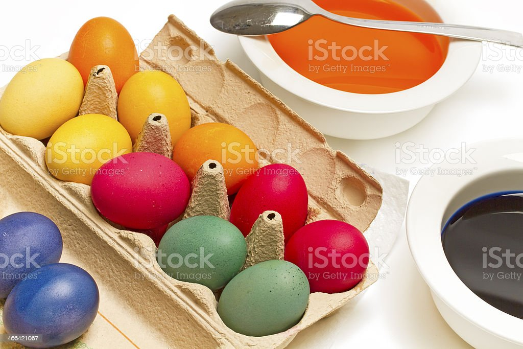 Painting easter eggs with different colours royalty-free stock photo