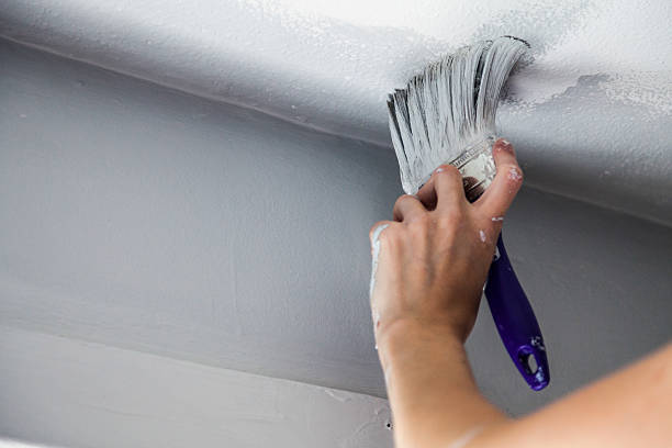 Painting Edges of the Ceiling stock photo