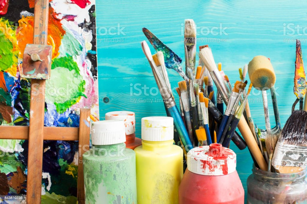 Painting Equipment Painting equipment, paint, brushes and  pallet. Acrylic Painting Stock Photo