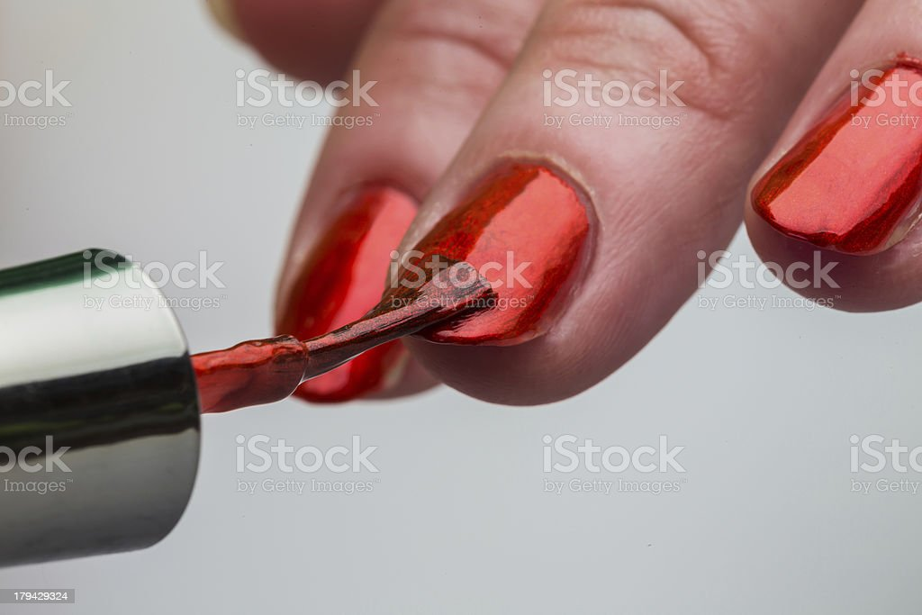 Painting female fingernails royalty-free stock photo