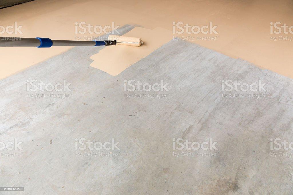Painting Floor of Garage stock photo