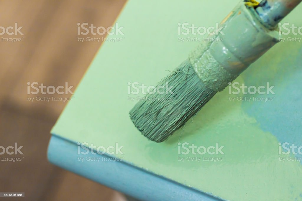 Painting green and blue stock photo