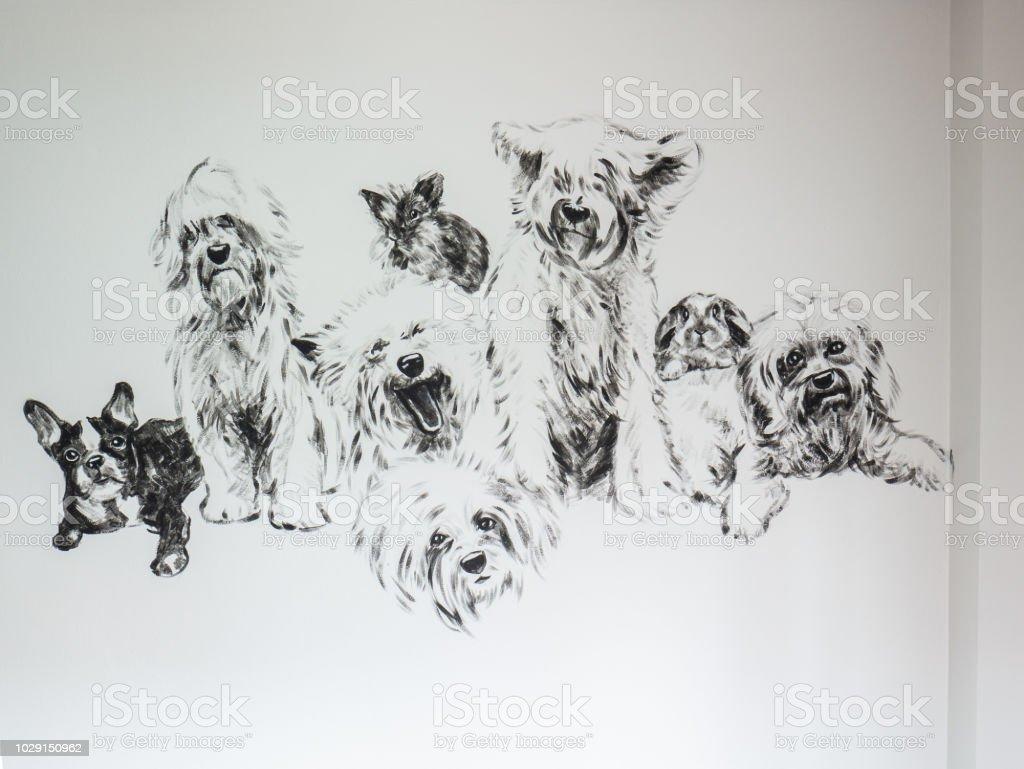 Gruppe von Hunden mit Kaninchen, schwarz und weiß Acryl auf Grauzement Wand Hintergrund malen. – Foto