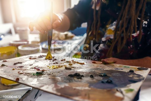 937983086 istock photo Painting, hand holding a palette and brush 1053904672