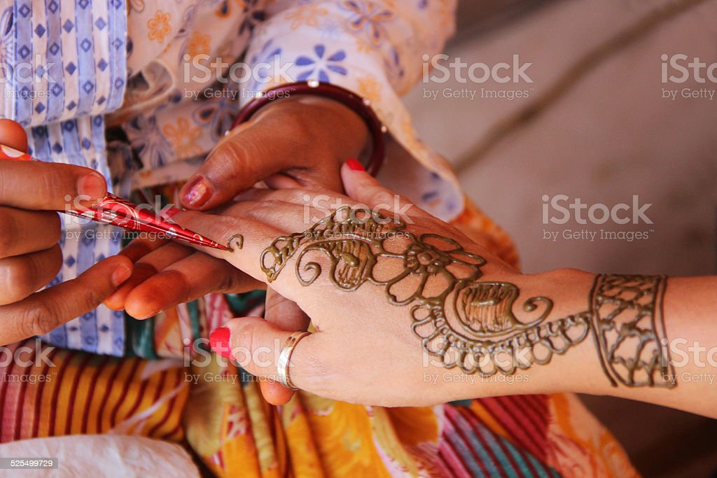Painting hand with henna in flower design stock photo