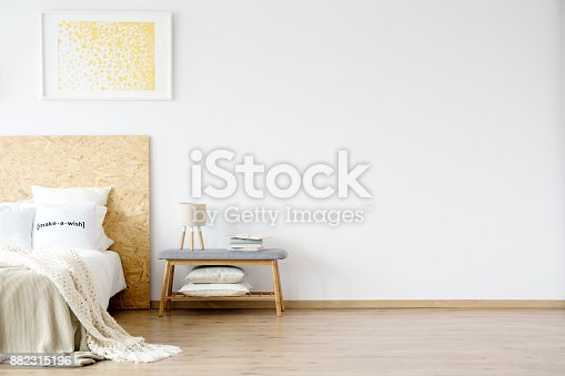 istock Painting hanging over bed 882315196