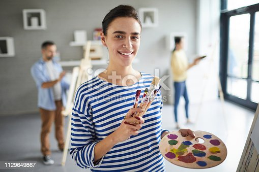 824254912 istock photo Painting in art studio 1129649867