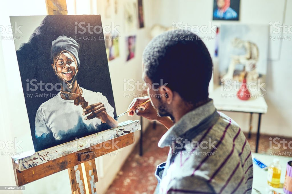 Painting is visual poetry Shot of a young male artist working in his studio 20-29 Years Stock Photo