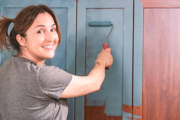 Painting kitchen. stock photo