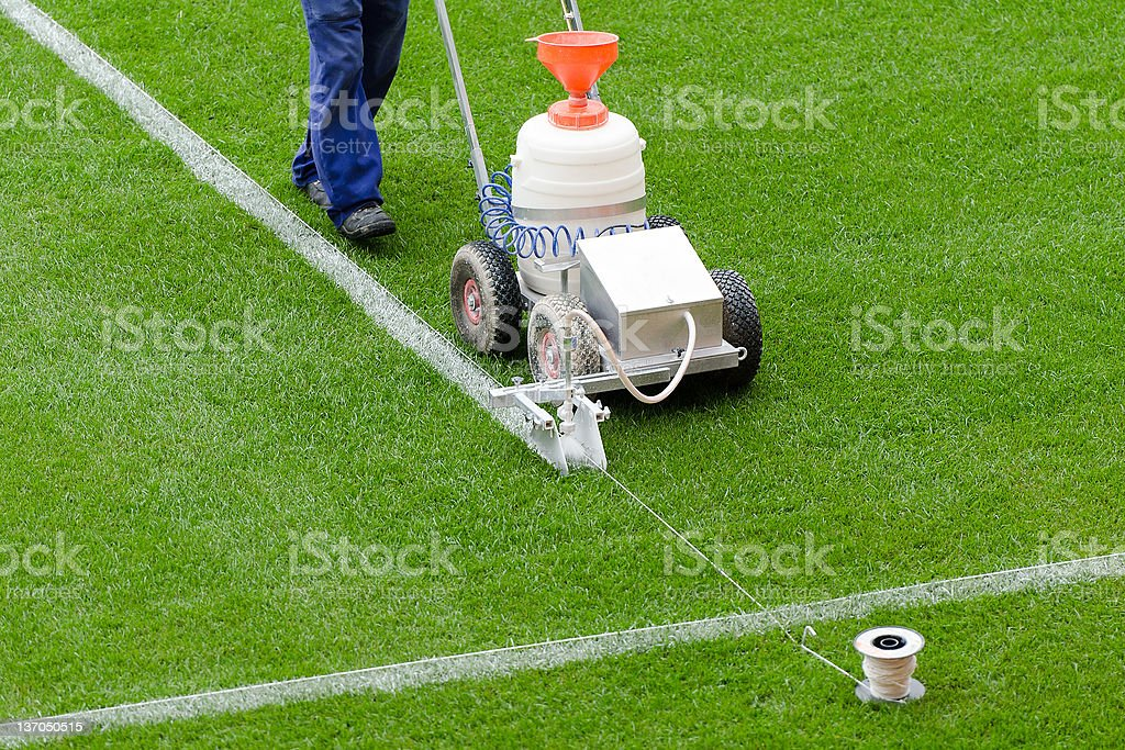 Painting lines on the playing field stock photo