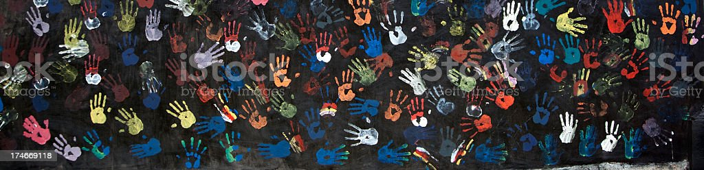 A painting of colorful handprints stock photo