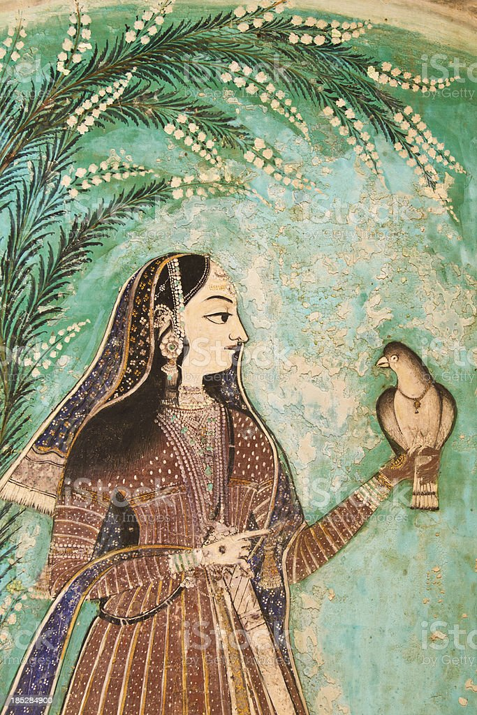 Painting of Indian Woman with bird stock photo