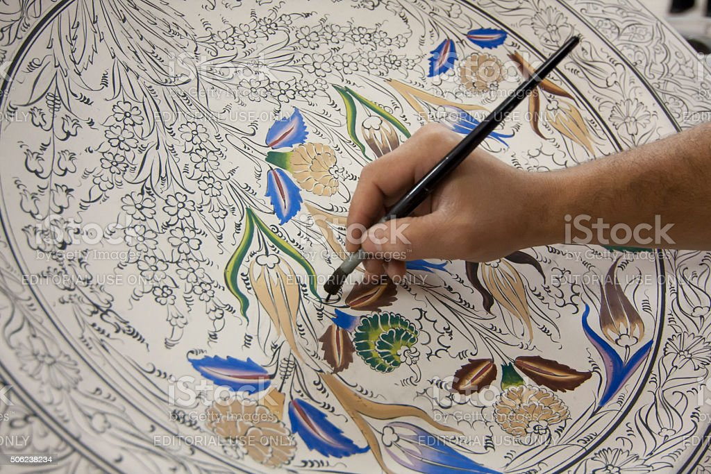 Painting of porcelain by hand. A traditional iznik ( Nicea )pattern. stock photo