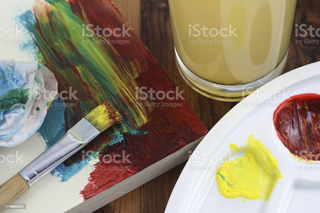painting of watercolors on a paper pad with paintbrushes royalty-free stock photo