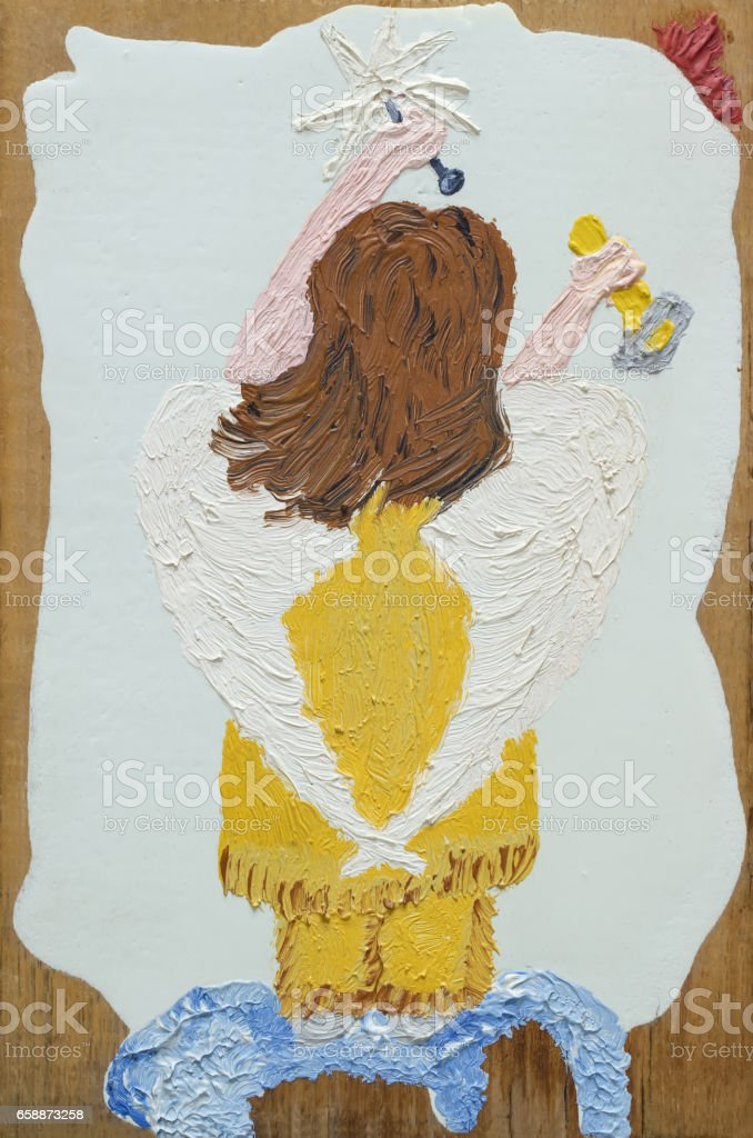 painting oil on wood 'Angel with star to sky' stock photo