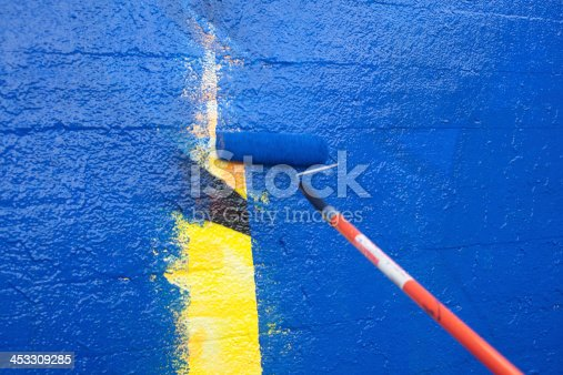 835790922istockphoto Painting over graffiti with a roller 453309285
