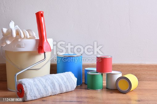 istock Painting pots for home on parquet in a room 1124381805