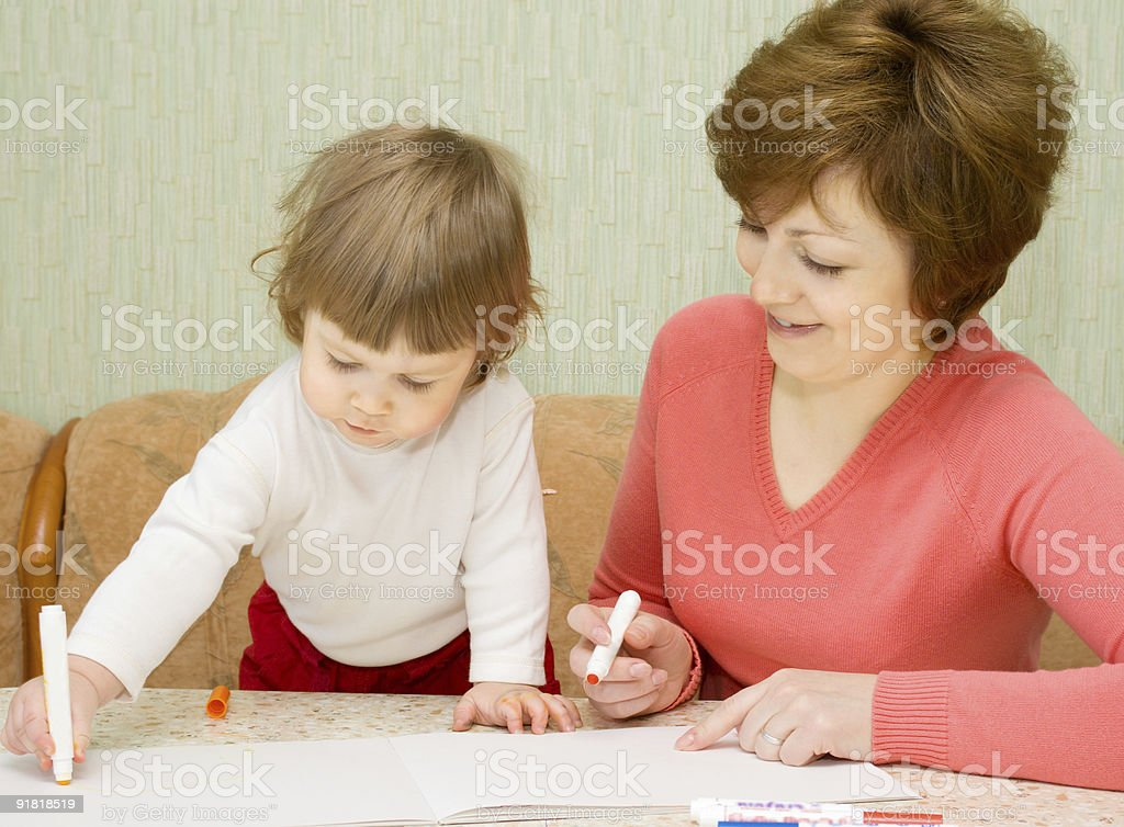 Painting small girl with mother royalty-free stock photo