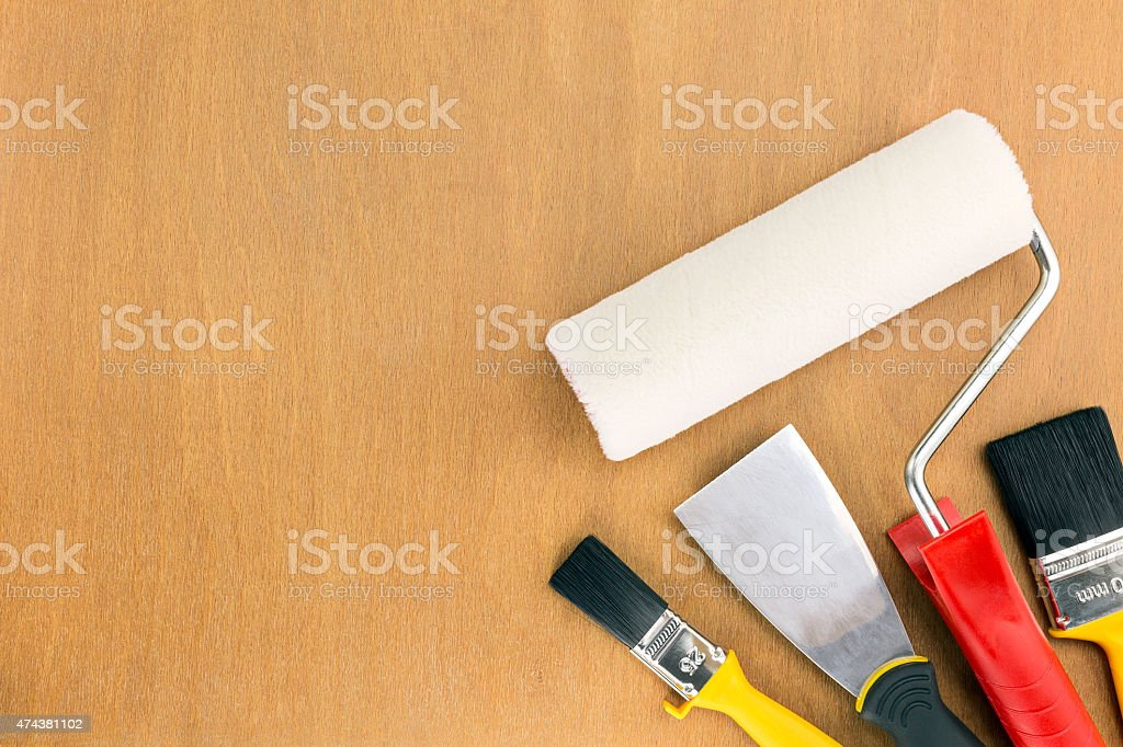painting supplies on wooden background stock photo
