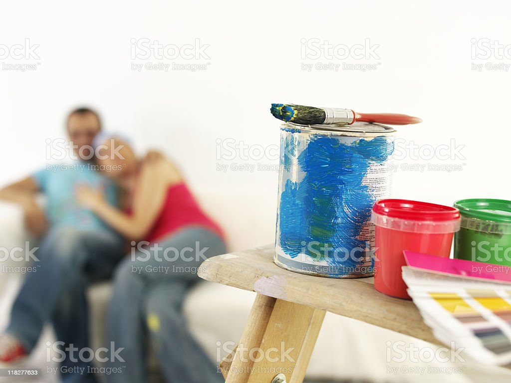 Painting supplies with young couple in background  royalty-free stock photo