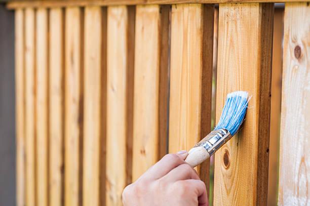 painting terrace railings - houtbeits stockfoto's en -beelden