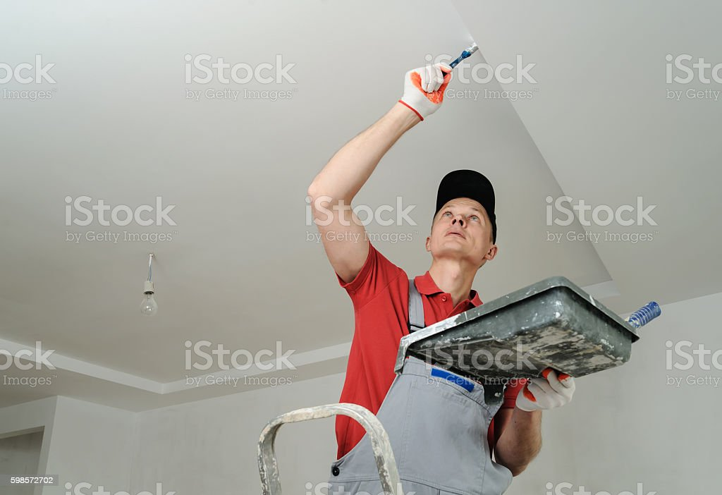 Painting the ceiling and walls. stock photo