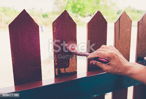 835790922istockphoto Painting the fence house 659477160