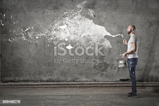 istock Painting the wall 639466276